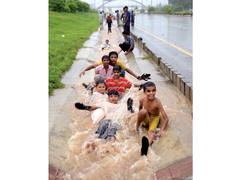 as the twin cities received their moderate share of monsoon rains young residents enjoyed the day with outdoor activities while others were either stuck in traffic jams on the inundated roads or busy pumping water out from inside their houses photo inp muhammad javaid express
