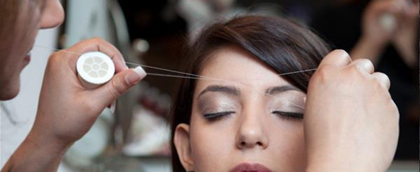 threading is a common way to shape eyebrows photo afp
