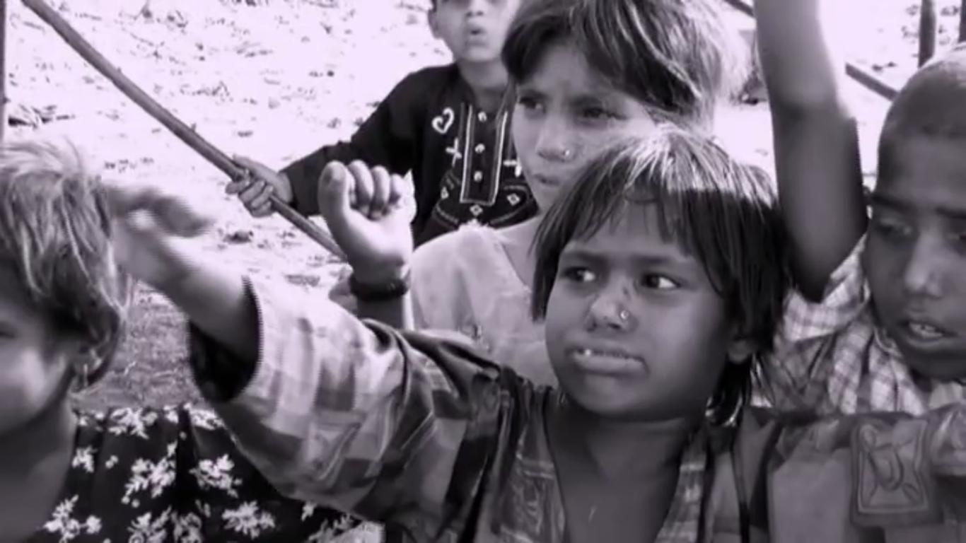 children in a slum near the river ravi lahore