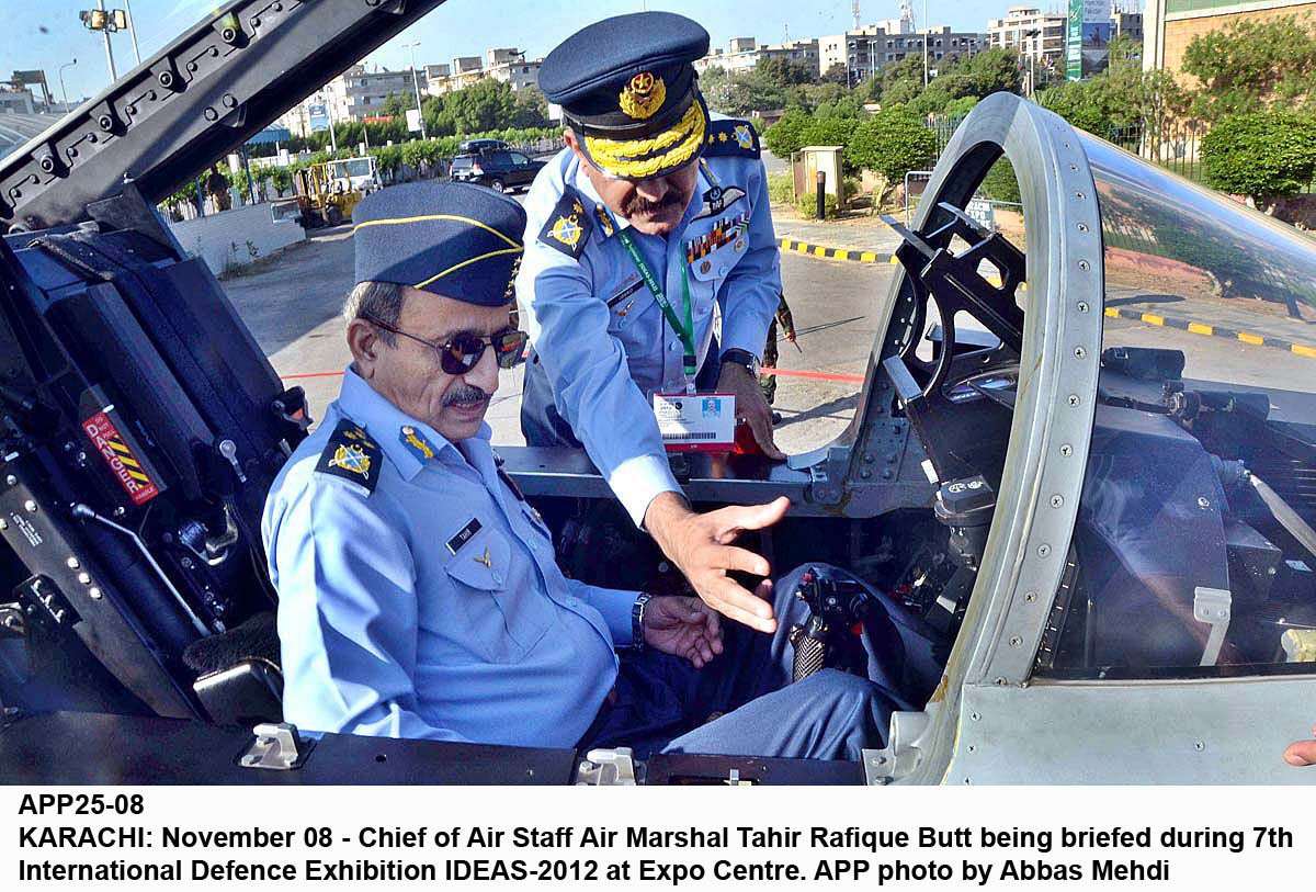 chief of air staff air marshal tahir rafiq butt sits inside the cockpit of a fighter aircraft and is briefed on the systems during ideas 2012 photo app file