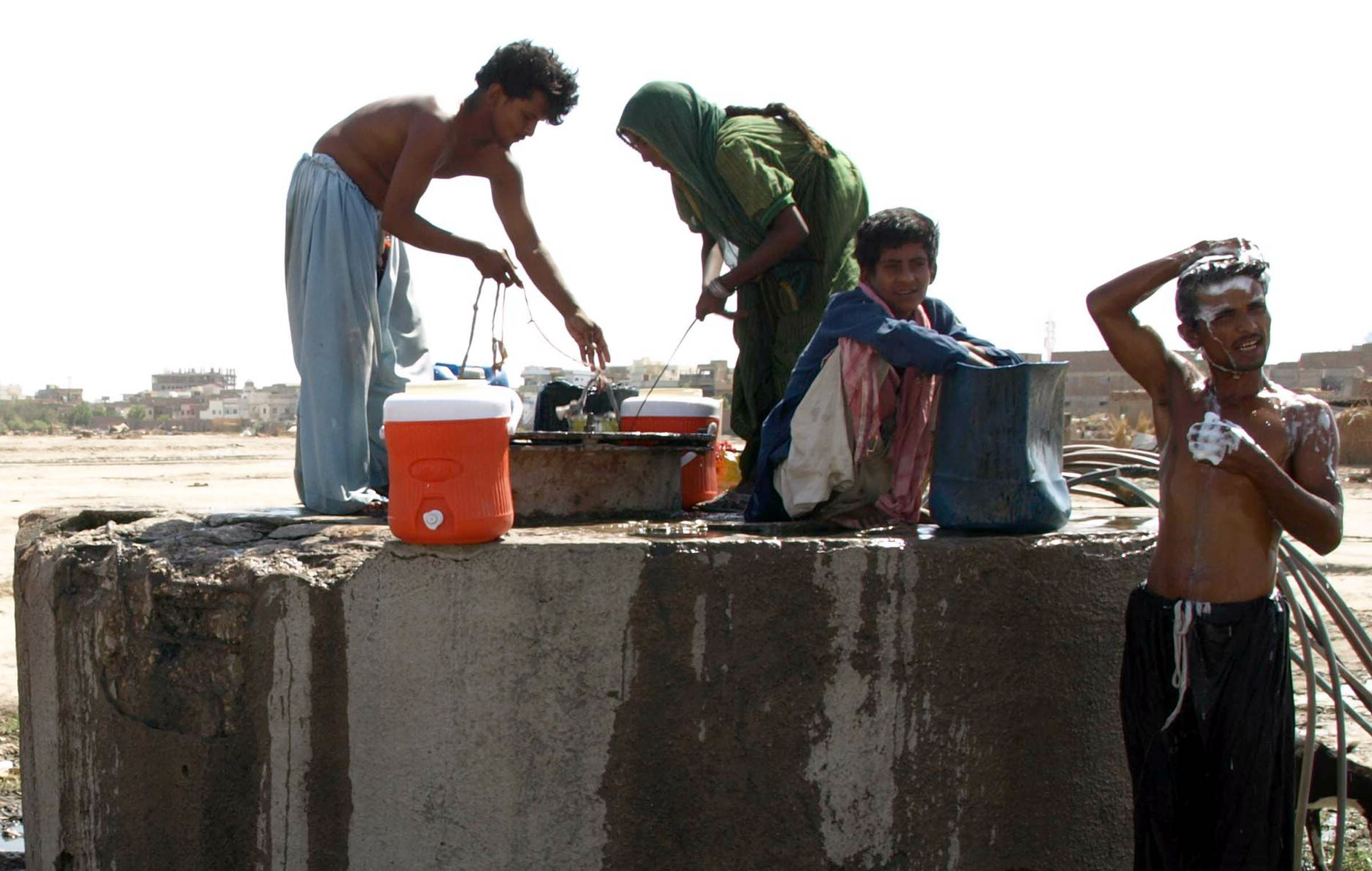 people taking drinking water from the water tank of wasa in hyderabad photo file
