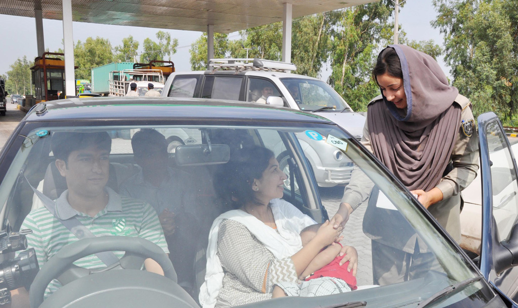 friendly a motorway policewoman distributes eid gifts to commuters as part of a special public campaign photo nni