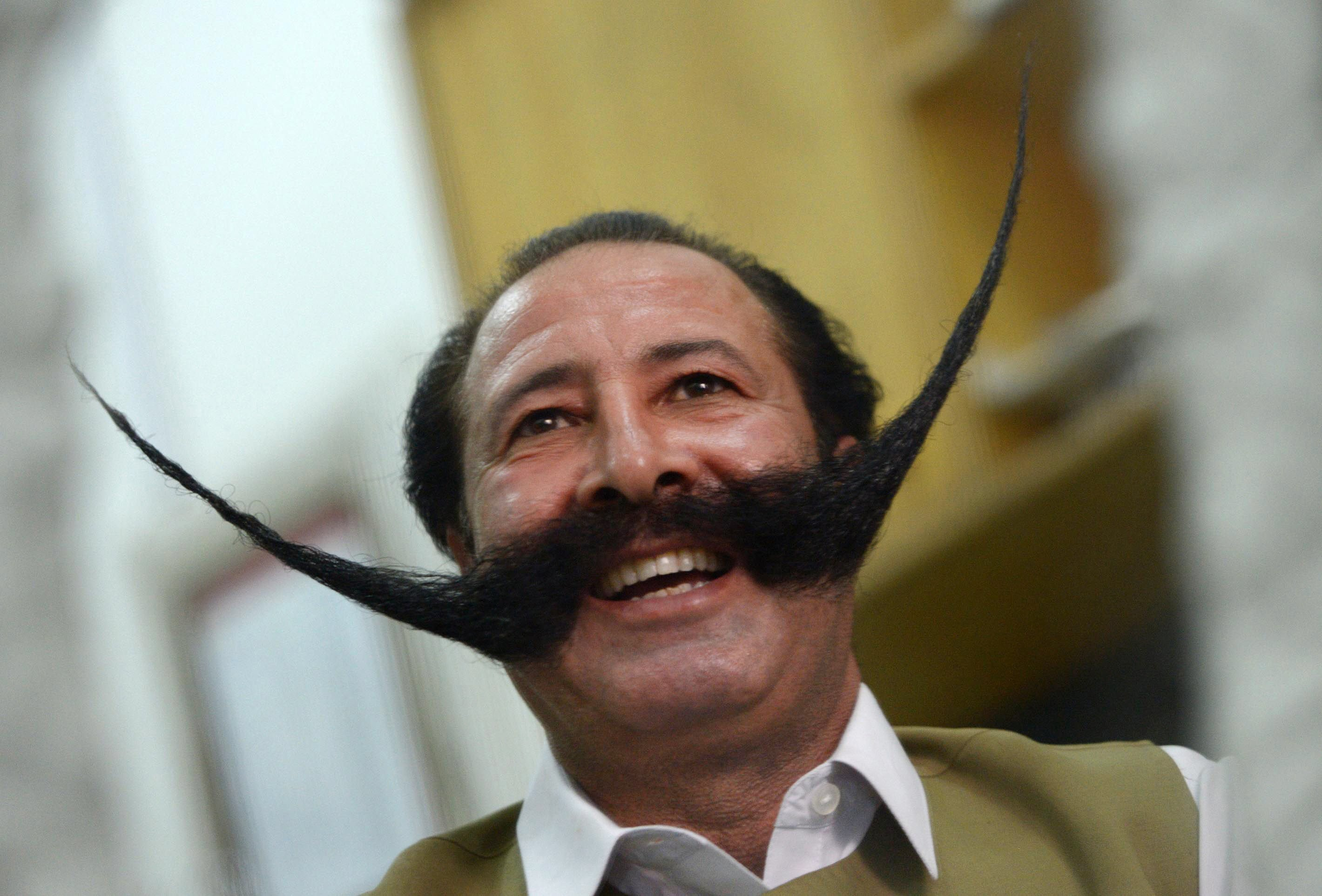 in this photograph taken on july 24 2013 pakistani businessman malik amir mohammad khan afridi smiles during an interview with afp in peshawar photo afp