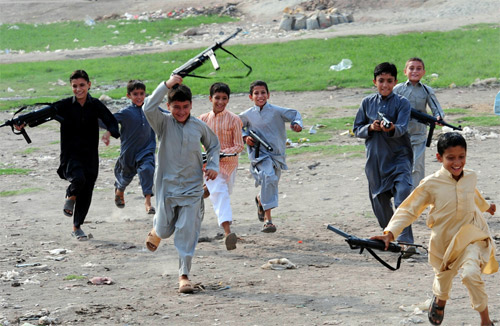 a large number of children many under the age of 10 can be seen carrying toy guns of all shapes and sizes photo afp file