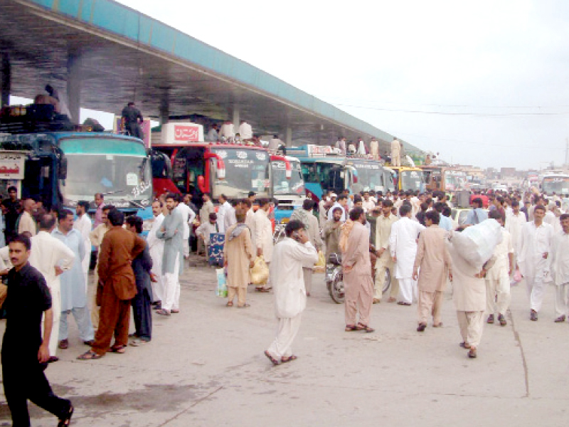 the twin cities residents thronged bus stations on the eve of eidul fitr which they will celebrate with relatives back in their home towns photo inp