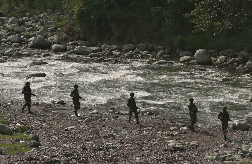 indian border security force bsf soldiers patrol next to a stream near the line of control loc a ceasefire line dividing kashmir between india and pakistan at sabjiyan sector of poonch district august 8 2013 photo reuters
