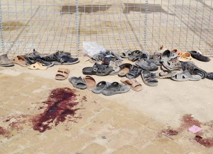 footwear is seen near a pool of blood at the site of gun battle in quetta august 9 2013 photo reuters