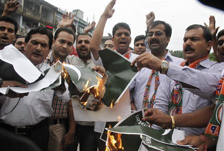members of the youth wing of bjp shout slogans and burn pakistan 039 s national flags during a protest in chandigarh photo reuters file