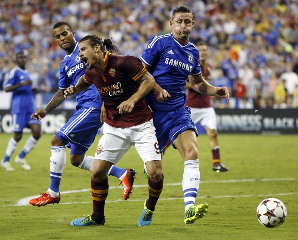 as roma 039 s pablo osvaldo reacts as he collides with chelsea defenseman gary cahill r during the second half of their friendly soccer match in washington august 10 2013 photo reuters