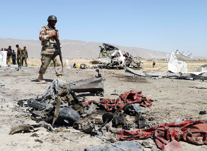 pakistani security officials are pictured at the site of a bomb attack on a vehicle used by security forces on the outskirts of quetta photo afp file
