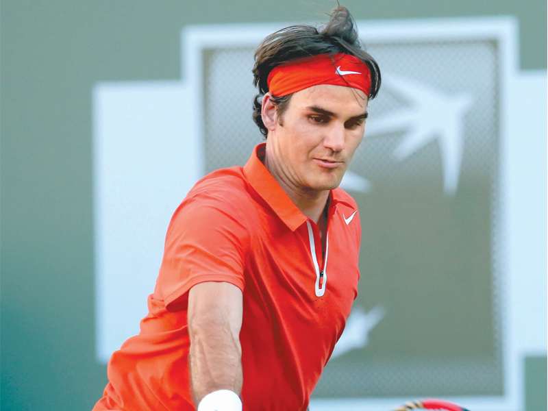 roger federer to face a fitness test as he is battling a back injury which refuses to ease and which caused him to withdraw from the montreal masters photo afp