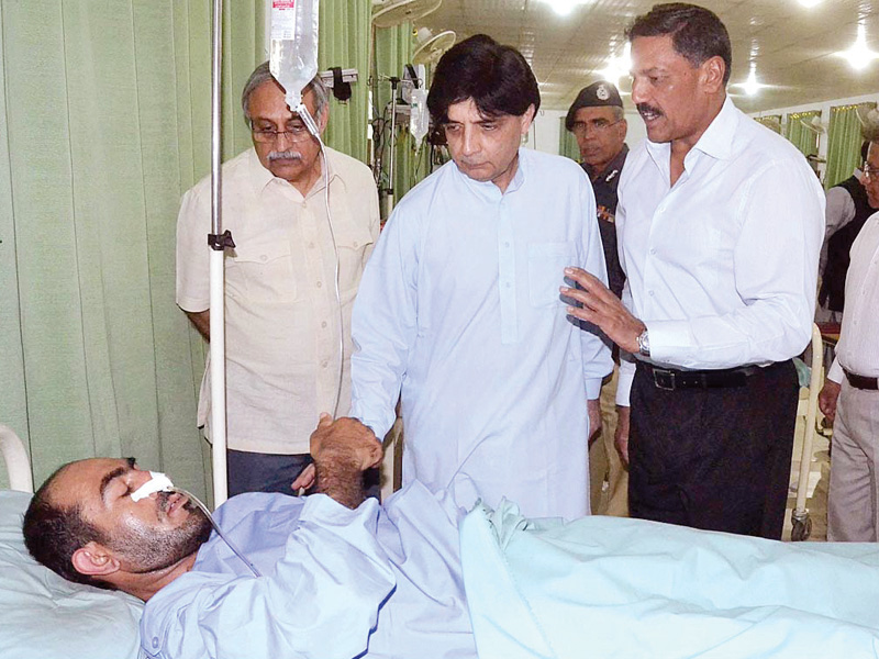 interior minister chaudhry nisar inquires after the health of police lines blast victim at cmh photo app