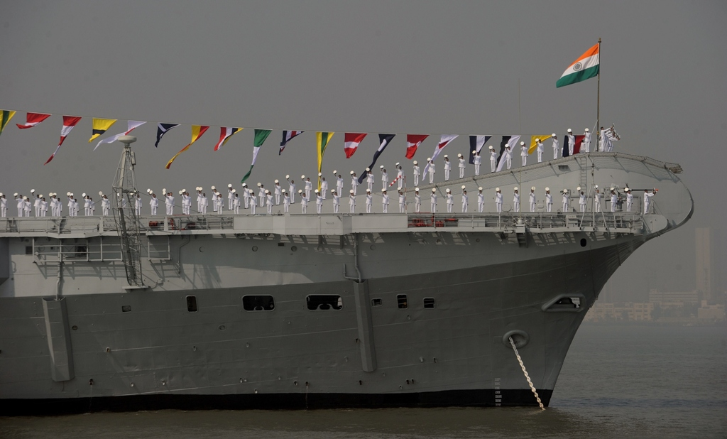 indian naval sailors stand on the deck of aircraft carrier ins viraat during a the fleet review pfr 11 in mumbai on december 20 2011 photo afp
