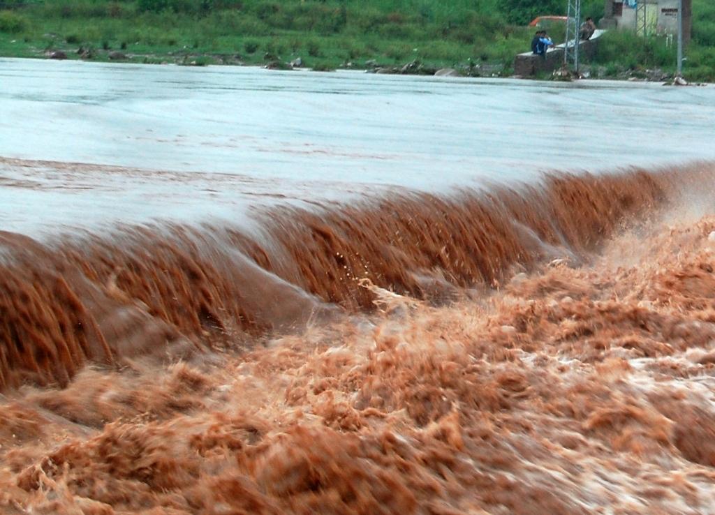 flooded water of nullah korang crossing over a causeway bridge after heavy rain started midnight till saturday morning in twin cities of rawalpindi islamabad photo muhammad javaid