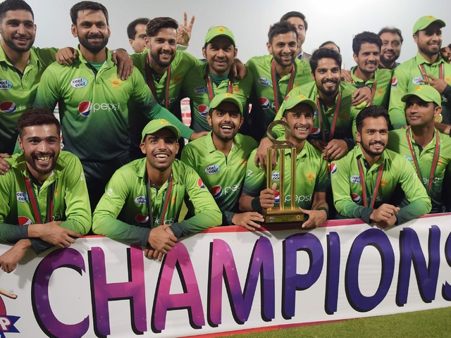 The Pakistan team poses with the trophy  after winning the T20 series against Sri Lanka in Lahore. PHOTO: AFP