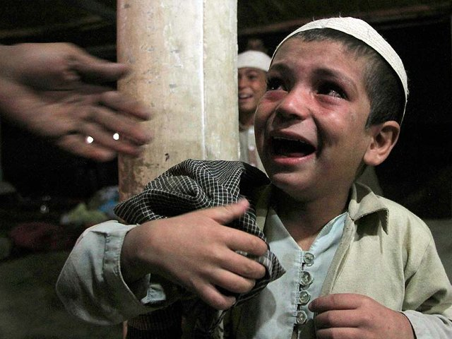 A Pakistani child weeps after being rescued by police Photo: AP