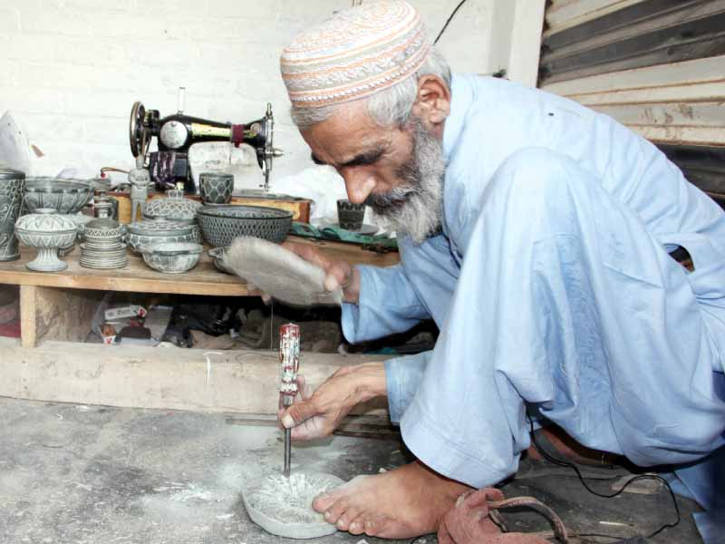 Ramzan's carvings are inspired by Gandhara artifacts. PHOTO: FAZAL KHALIQ / EXPRESS