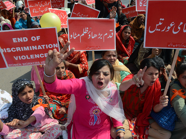 Pakistani human rights activists shout slogans during International Women's Day in Lahore on March 8, 2014. PHOTO: AFP