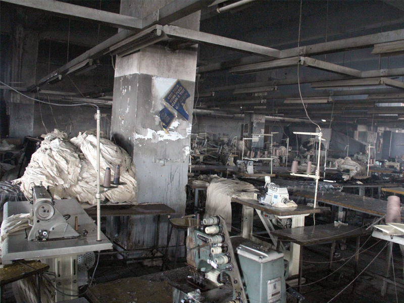 the sewing floor of the garment factory was charred in the fire that took the lives of over 250 workers even though there is a fire extinguisher the factory lacked proper fire exits photo file
