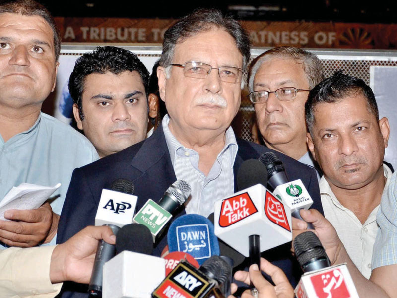 Minister for Information and Broadcasting Pervaiz Rasheed talking to media after inaugurating the exhibition on death anniversary of Quaid-e-Azam. PHOTO: NNI