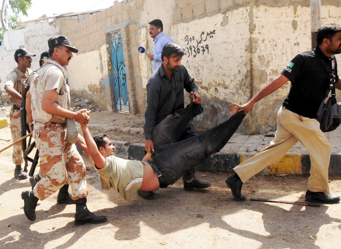 Ranger arresting suspects involved in a clash between two groups. PHOTO: RASHID AJMERI/EXPRESS/FILE