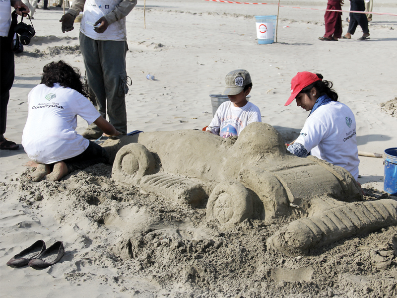 children build a race car out of sand on sunday in the third sandcastle building competition at sea view clifton organsied by let s build on this competition is part of their activity to create awareness about keeping beaches clean photo ayesha mir express