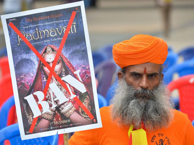 an activists of the karnataka wing of rashtriya rajput karni sena caste organisation holds a placard demanding the ban on screening of bollywood movie padmavati in bangalore photo afp