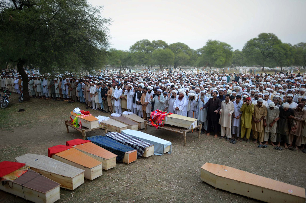 relatives and residents offer funeral prayers for blast victims in shabqader on september 29 2013 photo afp