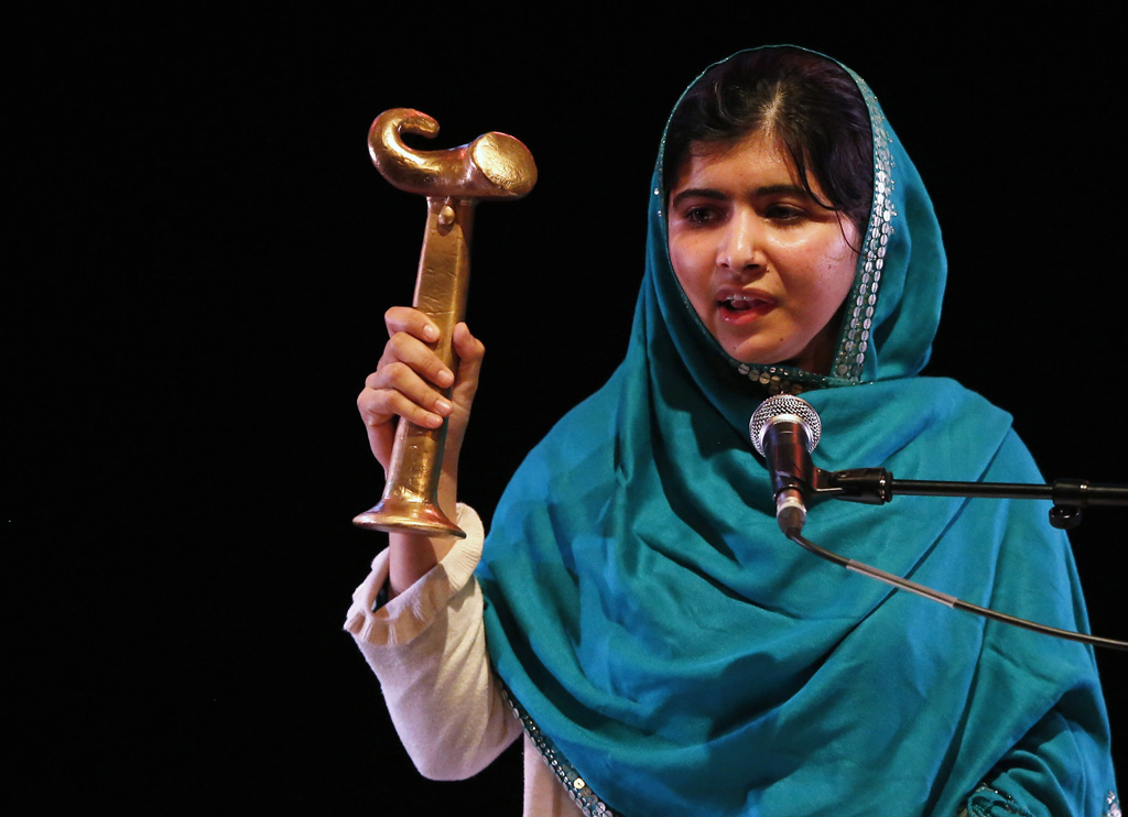 malala yousafzai waves her raw reach all women in war anna politkovskaya award while giving a speech after receiving the award at the southbank centre in london october 4 2013 photo reuters