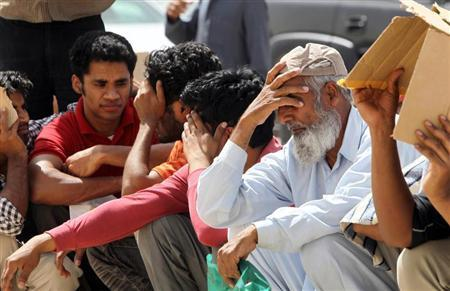 Illegal immigrant workers wait in line at the Saudi immigration offices at the Alisha area, west of Riyadh May 26, 2013. PHOTO: REUTERS