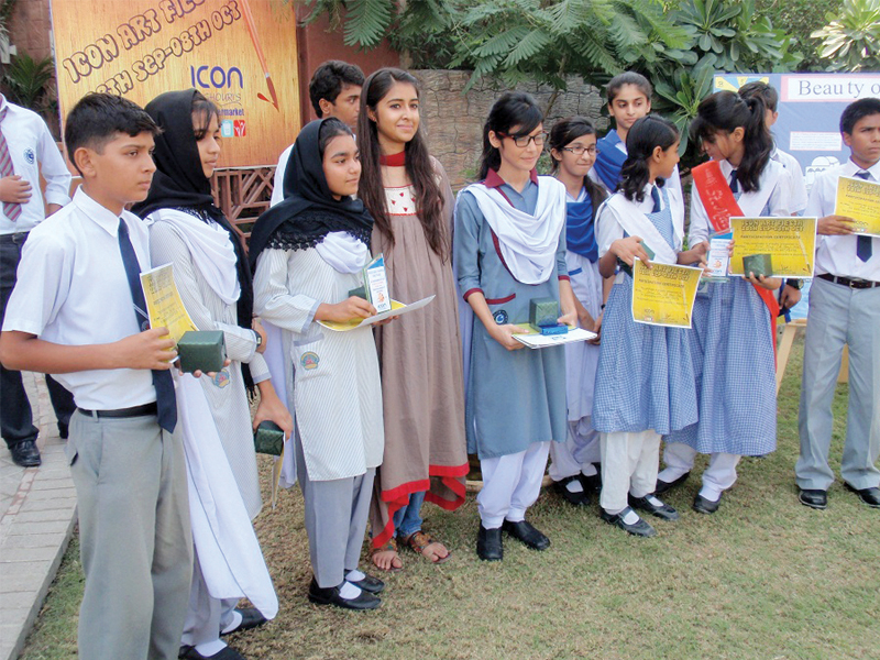 Participants of the art fiesta, organised by superstore Ghouri's Icon were awarded prizes for their outstanding artworks based on different themes. The competition was organised by the susperstore's owner to encourage the students to express their opinions using art and paintings as a medium. PHOTO: EXPRESS