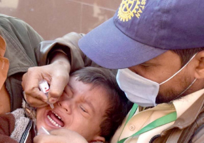 a health worker administers anti polio drops to a child in hyderabad photo inp