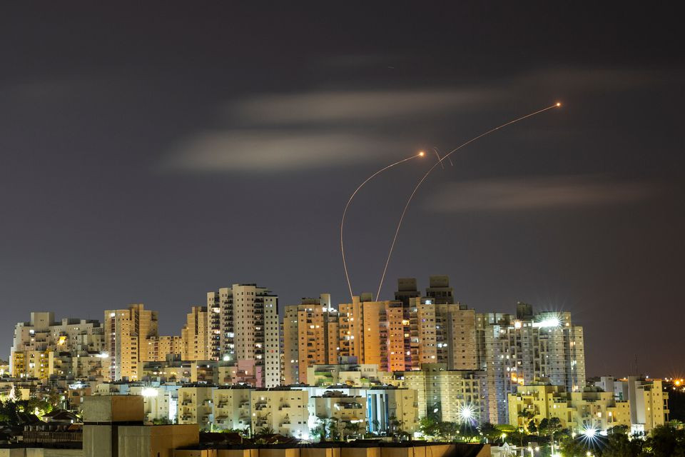 Streaks of light are seen as Israel's Iron Dome anti-missile system intercepts rockets launched from the Gaza Strip towards Israel, as seen from Ashkelon May 20, 2021. PHOTO: REUTERS