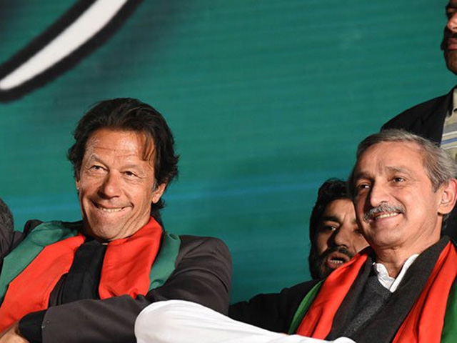 Imran Khan gestures to supporters at the anti-government rally in Islamabad. PHOTO: AFP