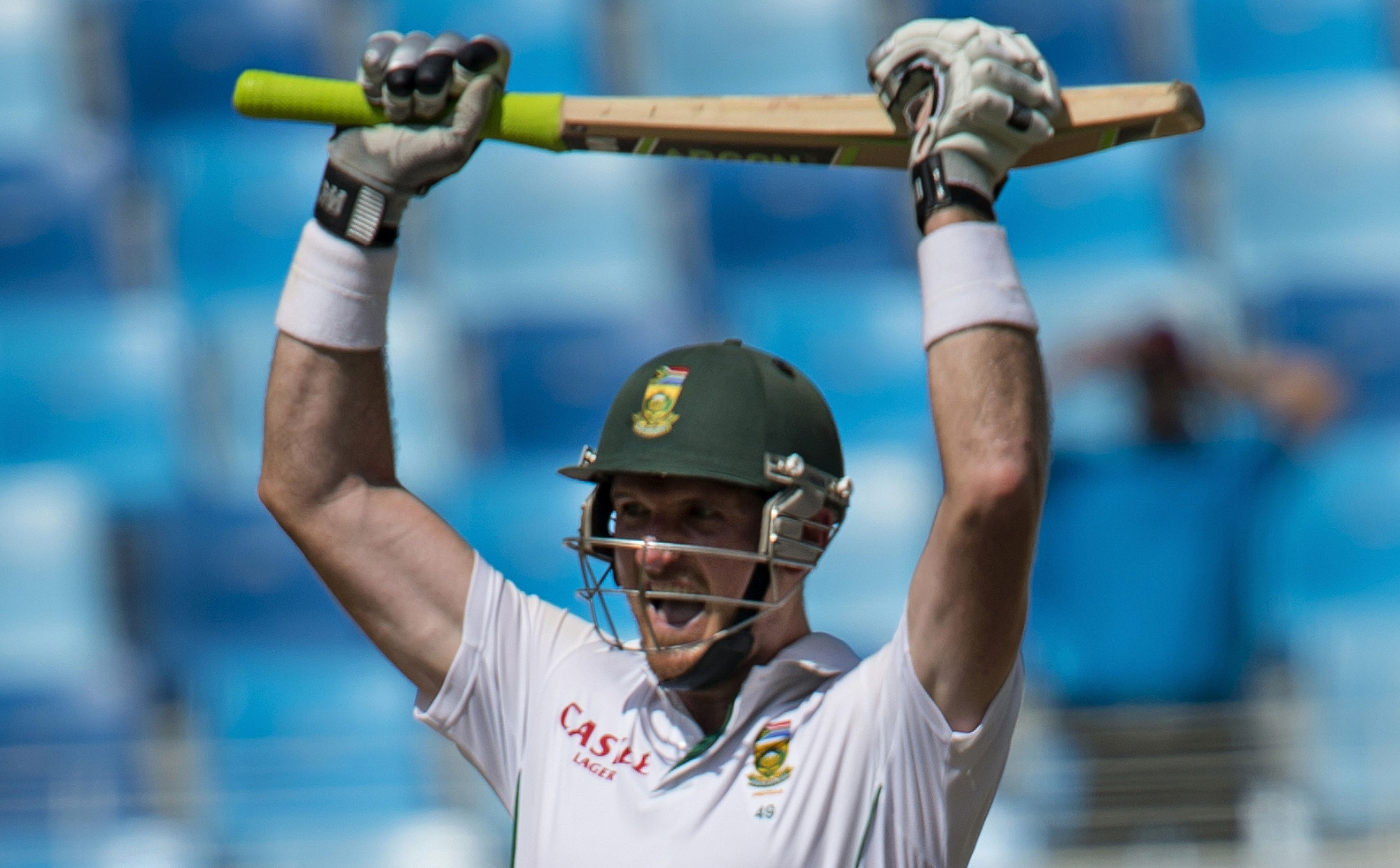 South Africa's captain Graeme Smith celebrates a century (100 runs) during the second day of the second Test Match between Pakistan and South Africa at the Dubai International Cricket Stadium on October 24,  2013. PHOTO: AFP