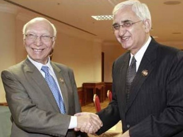 indian external affairs minister salman khurshid and advisor to prime minister on national security sartaj aziz photo radio pakistan