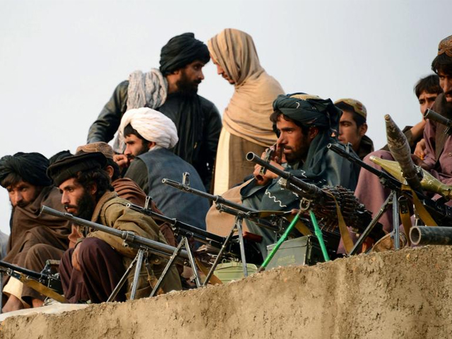 Afghan Taliban fighters listen to an unseen Mullah Mohammad Rasool Akhund, the newly appointed leader of a breakaway faction of the Taliban, at Bakwah in the western province of Farah on November 3, 2015. PHOTO: AFP