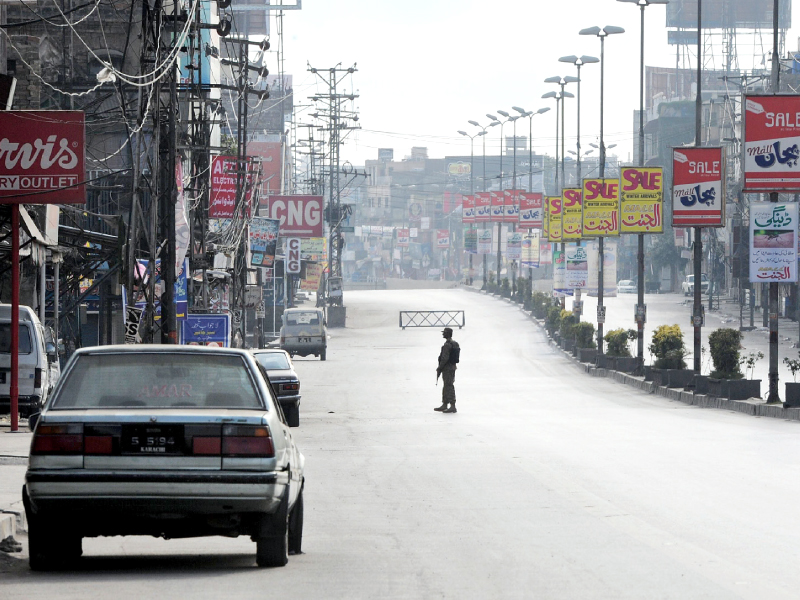An army soldier keeps watch during a curfew in Rawalpindi. PHOTO: AFP