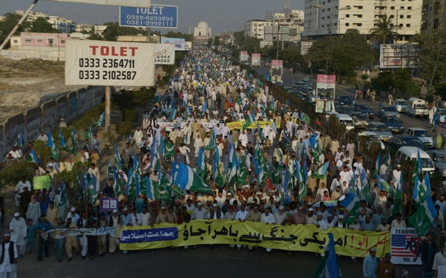 Activists of Jamaat-e-Islami Pakistan march in a protest rally in Karachi on November 24, 2013. PHOTO: AFP
