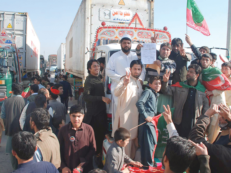PTI workers block the way of a Nato container in Peshawar. PHOTO: EXPRESS