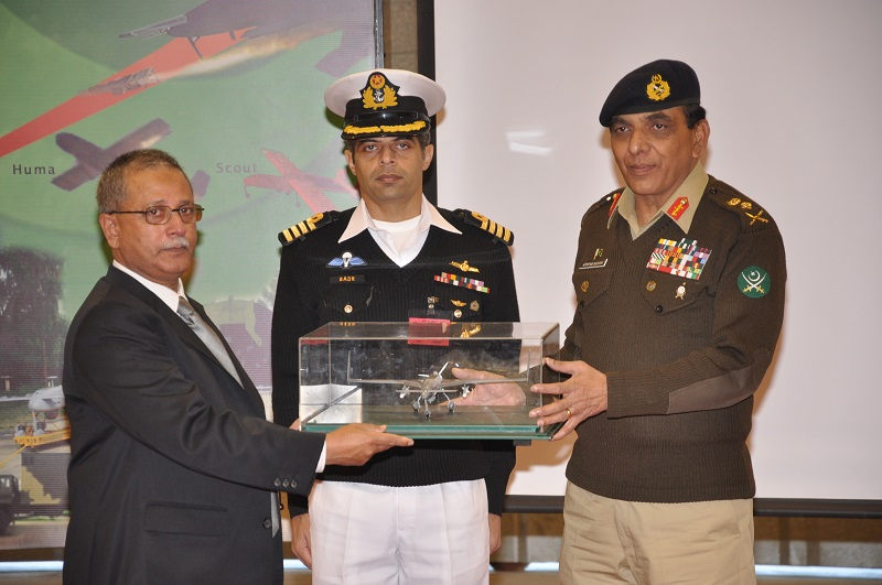 director general strategic plans division lieutenant general retd khalid ahmed kidwai handing over replica of indigenously developed surveillance capable uavs formally inducted in pakistan armed forces to chief of army staff general ashfaq parvez kayani photo ispr