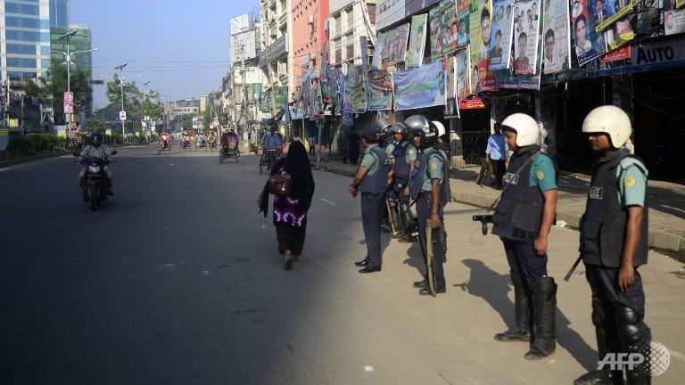 bangladeshi police personnel stand guard during the second day of a nationwide strike called by the opposition bnp in dhaka photo afp