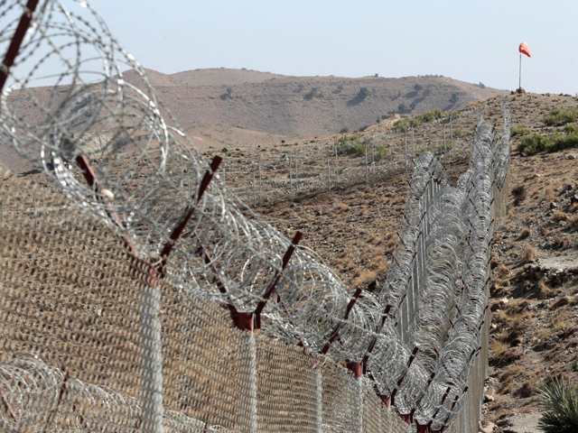 A view of the border fence outside the Kitton outpost on the border with Afghanistan in North Waziristan, Pakistan October 18, 2017. PHOTO: REUTERS