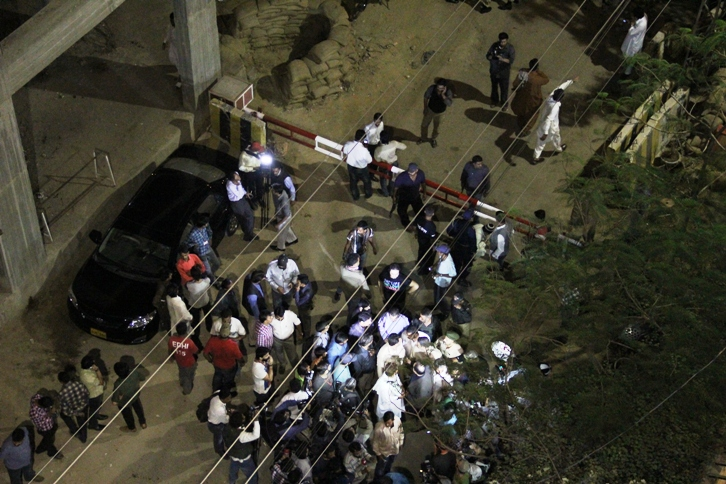 a crowd gathers at the front of the express news office after the attack photo ayesha mir express