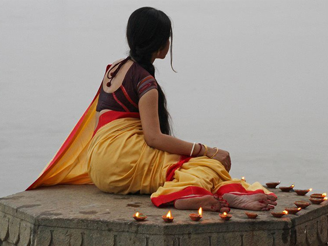 Clad in silk sarees, of new colours on new days, she'd wait for Naveed before he returned home from work. PHOTO: PINTEREST