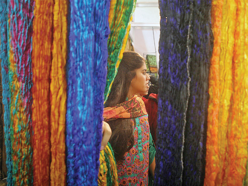 Indian traders exhibit brightly coloured fabrics that have been weaved using traditional methods. PHOTO: ATHAR KHAN/EXPRESS