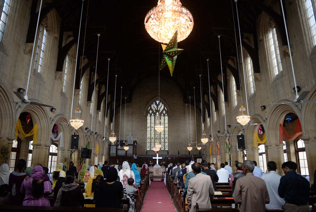 Pakistani Christians attend a Christmas Day mass at St. Patrick's Cathedral in Karachi on December 25, 2013. PHOTO: AFP