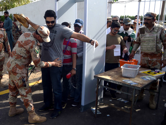 Rangers personnel check cricket fans before they enter the National Cricket Stadium on March 25, 2018. PHOTO: AFP