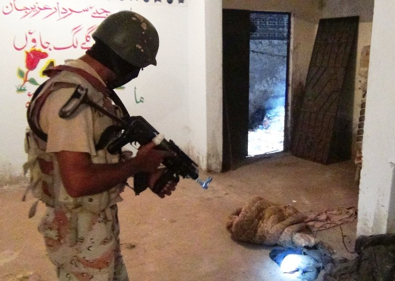 Rangers personnel carry out a target search operation in Karachi's Lyari district. PHOTO: PPI/FILE