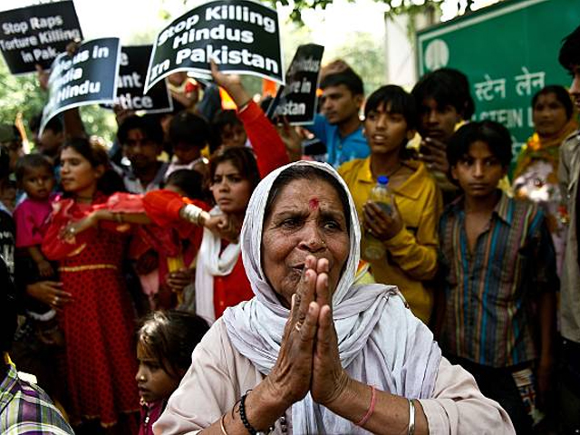 a minority hindu refugee from pakistan gestures during a protest outside the united nations office in new delhi on april 17 2013 photo getty